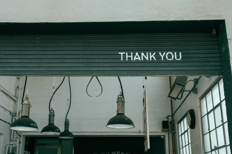 thank you sign with light fixtures
